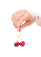 hand holding  two cherries on white background