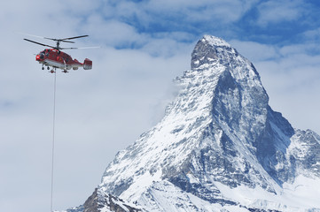 Helicopter flew over Matterhorn peak  in Zermatt, Switzerland