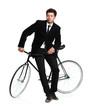 Attractive man in a classic suit with a bicycle on a white