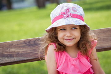 Portrait of cute little girl in a park