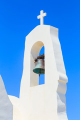 A closup of a bell of a white chapel, Cyprus