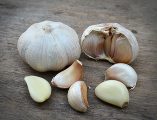 Garlic whole and cloves on the wooden table