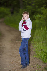 Portrait of a boy in the evening in the park