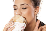 beautiful girl voraciously eating her sandwich poster