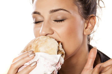 beautiful girl voraciously eating her sandwich