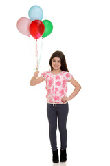 little girl holding balloons
