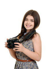 Little girl holding dslr camera