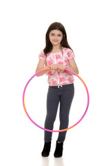 little girl holding hula hoop