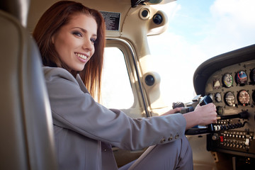 Female pilot preparing for a flight in a light aircraft