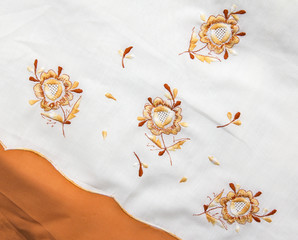 bedsheet with embroidered flowers