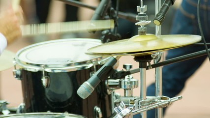 Drummer play music on drums and cymbal