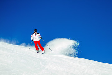 Expert Male Skier Carving Through Fresh Snow