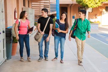 Teenage friends in a hallway