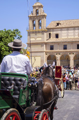 MALAGA, SPAIN - AUGUST, 14: Horsemen and carriages at the Malaga