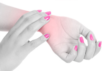 woman with wrist pain and pink nails