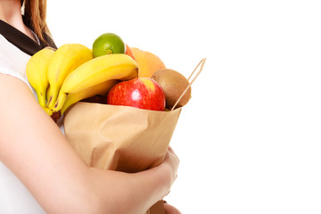 Grocery. Paper shopping bag with fruits in female hands