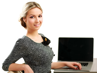 young woman with a laptop sitting isolated on white background