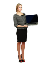 Young beautiful woman showing a laptop