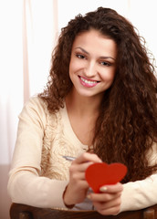 Beautiful smiling woman with heart symbol
