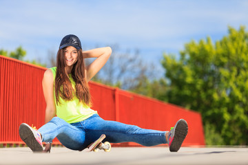 Summer sport. Cool girl skater with skateboard
