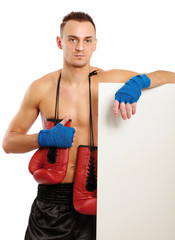 Young boxer man standing near board , isolated on white