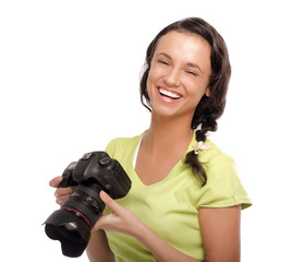Young woman with camera.Isolated on white background