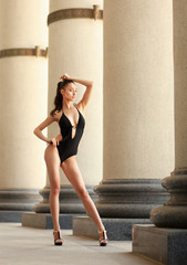 Attractive girl in high fashion swimming suit