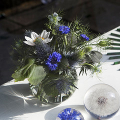 Beautiful bouquet of wild flowers with blue burr, cornflower