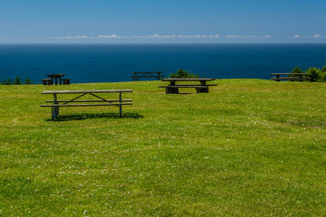 Picinic benches and tables at the ocean
