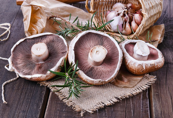 Portobello mushrooms over rustic wooden background