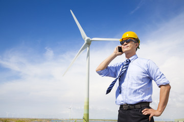 professional business standing with wind generator