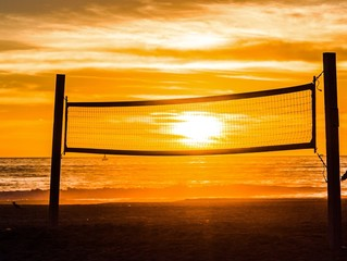 sun caught in volleyball net