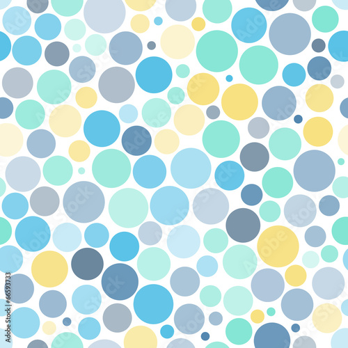 Seamless background with colorful dots © karandaev