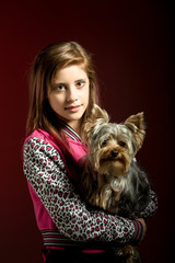 smiling young girl with her pet yorkshire