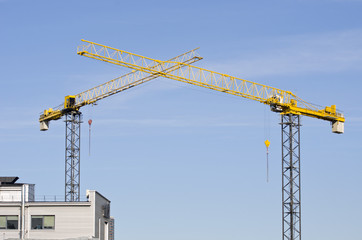 two building crane on sky background