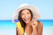 Sunscreen woman applying suntan lotion