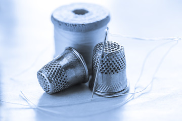 Thread bobbins and sewing thimbles