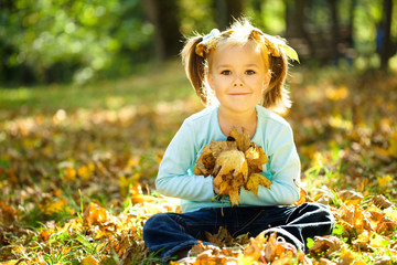 Portrait of a little girl in autumn park
