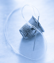 Sewing thimble and needle with thread