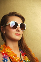Girl with sunglesses and hawaiian wreath