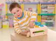 little boy to school in the Montessori