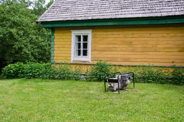 diesel electricity generator work near rural house