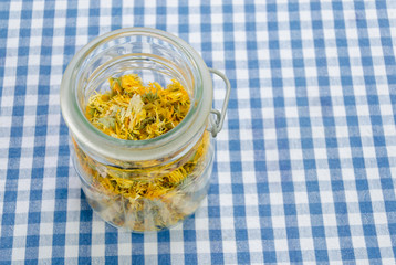 jar of dried organic herbal healing calendula