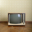 retro tv with wooden case in room with vintage wallper and parqu