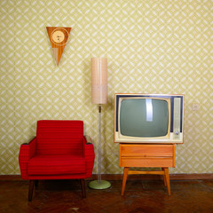 Vintage room with wallpaper, old fashioned armchair, retro tv, c