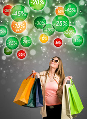 Shopping woman looking at discounts