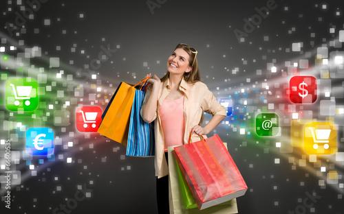 Leinwandbild Motiv shopping woman surrounded by icons of e-commerce