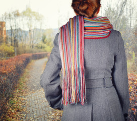 Young woman walking in the fall season