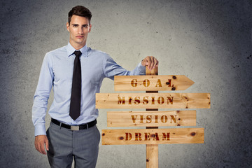 Success businessman with wooden sign