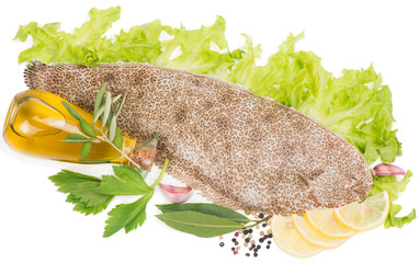 View from above of a fresh sole with spices.